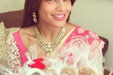 Bipasha picks floral, pink for Mehendi ceremony
