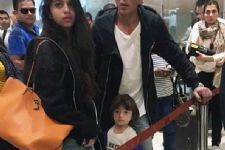 Can you caption this adorable photo of AbRam with SRK & Suhana