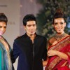 Models with designer Manish Malhotra walk on ramp at Aamby Valley Indian Bridal Week day 5