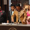 Akshay Kumar cuts a piece of the special Black forest cake for Aishwarya on Amul Master Chef India