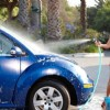 Amrita Arora washing the car