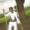 Shahrukh sitting on a swing | Billu Barber Photo Gallery