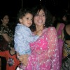Tanaaz Irani with her new look with her son Zeus in arms