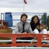 Neil and Bipasha sitting on a truck