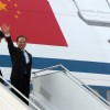 Chinese Premier Wen Jiabao waves as he arrives for a three-day visit to India, in New Delhi, India, Wednesday, Dec. 15, 2010. Wen arrived Wednesday as part of efforts to build trust between the rival neighbors amid lingering disputes over ...