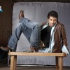 Tushar Kapoor sitting on a table