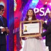 Amitabh Bachchan and Ramesh Sippy award Aishwariya Rai Bachchan at the 6th Apsara Awards