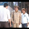 Rajpal Yadav and Govinda talking to someone