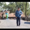 Govinda walking on a road