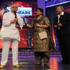 Pankaj and Supriya Pathak presenting Gulzar for Best Lyrics at the 56th Idea Filmfare Awards 2010. .
