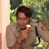 Ajay Devgan eating a icecream