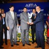 Anand Sharma,Minister for Commerce and Industry, Government of India presenting the AIMA - JRD Tata Corporate Leadership Award to Adi Godrej, Chairman, Godrej Group at the AIMA Foundation Day. Others in the picture from (l to r), Dr. Ram ...