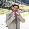 Anil Kapoor playing a harmonica