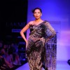 A model displays designer Satya Paul's creations during the Lakme Fashion Week 2011 Day 5 in Grand Hyatt, Mumbai. .