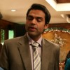 Abhay Deol and Neetu Chandra talking to a man