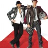 Arshad Warsi giving style and Akshay Khanna standing with a shooting products in Shortkut