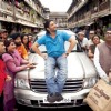 Arshad Warsi sitting on a car bonat in mohalla