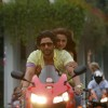 Arshad Warsi and Amrita Arora sitting on a bike