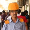 A IIT Delhi student with his innovated Head Load Transmitter at the Open House 2011 in New Delhi on Saturday. .
