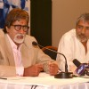 Film 'Aarakshan' director Prakash Jha with Amitabh Bachchan at a promotional event for his film,in New Delhi