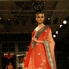 Model showcasing designer Manish Malhotra's creations at Synergy1 Delhi Couture Week,in New Delhi