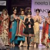 Models with designer Neeta Lulla during the Lakme Fashion Week Day 4 in Mumbai. .