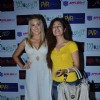 Uvika Choudhary and Liana Warner Gray- Miss Australia Earth 2009 at The Man in the Maze premiere at PVR