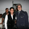 Amitabh Bachchan with Shah Rukh Khan on the sets of Kaun Banega Crorepati 5 in Mumbai