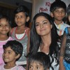 Veena Malik adopts Payal Kamble, a seven year old girl at Penninsula