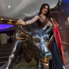 Mahima Chaudhary poses with a bronze statue of a bull after taking part in the Diwali Muhurat Tradin
