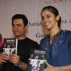 Aamir Khan and badminton ace Saina Nehwal play an exhibition match at launch of 'PULLELA GOPICHAND'Book in Mumbai