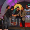 Ranbir Kapoor, Imtiaz Ali and Mohit Chauhan present AR Rahman with an award at the FICCI Frames Excellence Awards 2012. .