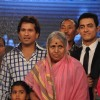 Sachin Tendulkar and Aamir Khan with Sindhutai Sakpal at CNN IBN Heroes Awards
