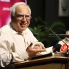 A poet and Union Minister Kapil Sibal reading a his poem at Jamia Millia Islamia University,in New Delhi