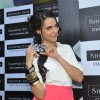 Neha Dhupia poses during the launch of Shoppers Stop Gift Cards