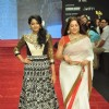 Anjum Farooki and Surbhi Tiwari walk on the ramp for Gitanjali Jewellers at IIJW in Mumbai
