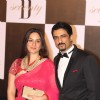 Sanjay Suri with wife at Amitabh Bachchan's 70th Birthday Party at Reliance Media Works in Filmcity
