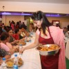 Tanisha serving bhog at North Bombay Sarbojanin Durga Puja 2012 in Juhu, Mumbai.
