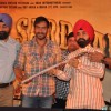 Bollywood actor Ajay Devgn with Congress leader Charan Singh Sapra and other members of Punjabi Cultural Heritage Board (PCHB) during of his upcoming film Son of Sardar press meet in Mumbai.