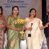 Asha Bhosle receiving award from Justice Gyan Sudha Misra and Justice Ranjana Desai on