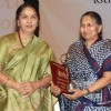 Naveen Jindal's mother Savitri Jindal receiving award from Justice Gyan Sudha Misra on
