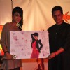 Nia Sharma receives trophy from Yash Patnaik at the celebration of India Forums 9th Anniversary