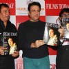 Bollywood actor Govinda with Rajesh Shrivastava, CMD, Films Today, filmmaker Raju Kariya during the launch of the 7th anniversary issue of 'Films Today' magazine in Mumbai.