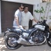 John Abraham gifts his favourite bike to director Sanjay Gupta
