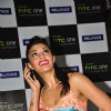 Jacqueline Fernandez poses for the photographers during the unveiling of new HTC One smart phone in Mumbai