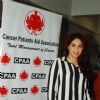 Indian Bollywood actress Neetu Chandra and pop singer Neha Bhasin at a cancer screening camp organised by the Cancer Patient Aid Association (CPAA) with Mumbai