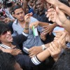 Fans crowd around Shahrukh Khan for an autograph,a hand shake or just a glimpse