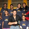 Shreyas Talpade shows off his Rakhis with his Rakhi sisters at the NGO