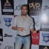 Mika Singh strikes a pose at the Premiere of JOBS