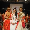 Esha Kopikar and Sonali Bendre showcase a creation of talent box at LAKME FASHION WEEK 2013